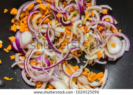 Chopped onions and carrrots in frying pan