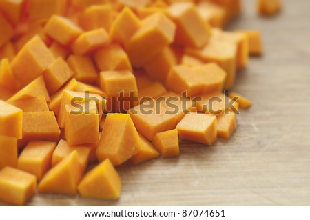 Chopped orange butternut squash on cutting board/Diced Squash