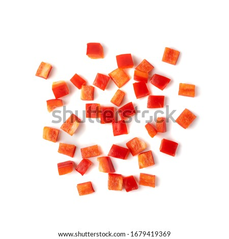 Chopped paprika or red sweet pepper cuts isolated on white background top view. Diced bell pepper