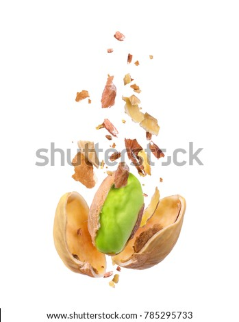 Chopped pistachio frozen in the air on a white background #785295733