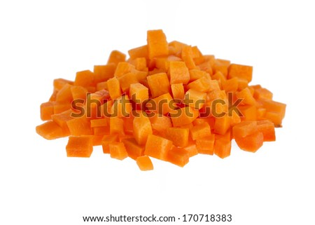 Chopped raw carrots isolated on white background.