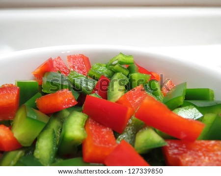 Chopped Red and Green Bell Peppers in bowl