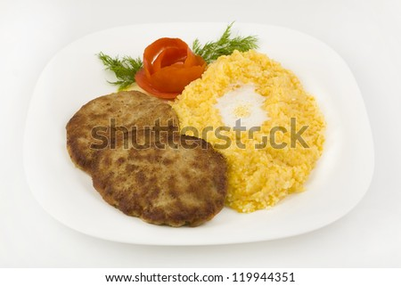 Chopped steak with corn porridge closeup on a white background - stock photo