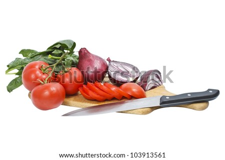 Chopped tomatoes and onions on a chopping board with a knife - isolated on white
