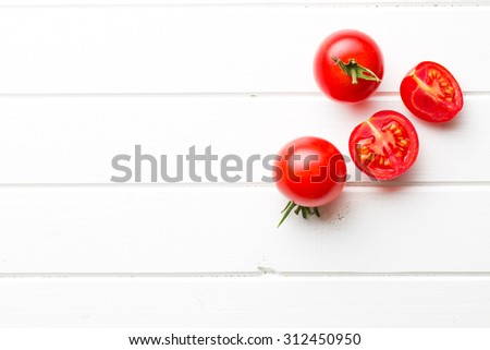 chopped tomatoes  on kitchen table