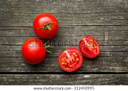 chopped tomatoes on old wooden table