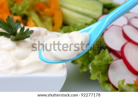 Chopped vegetables and sauce in spoon closeup