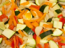 Chopped vegetables sizzling in the frying pan