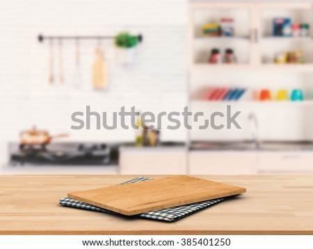 chopping board on wooden counter top with kitchen cabinet background