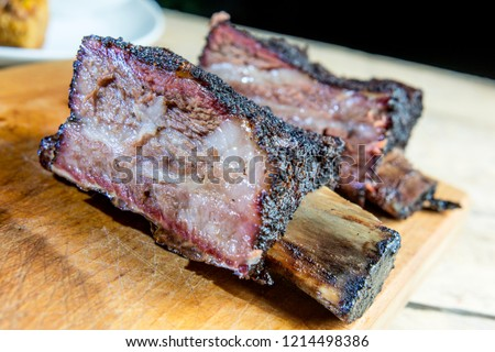 Chopping board with Smoked beef ribs cut on the table #1214498386