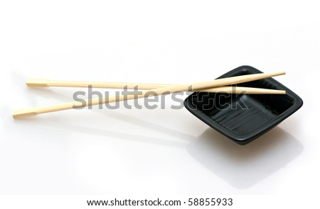 chopsticks and a wasabi dish isolated