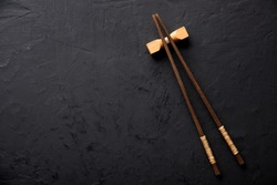 chopsticks on dark table
