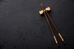 chopsticks on dark table
