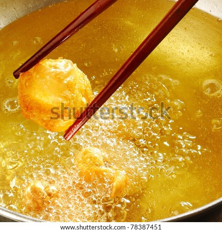 Chopsticks pick up fried dumplings - stock photo