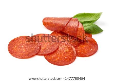 Photo of  Chorizo sausage slices, Traditional spanish sausage, isolated on white background.