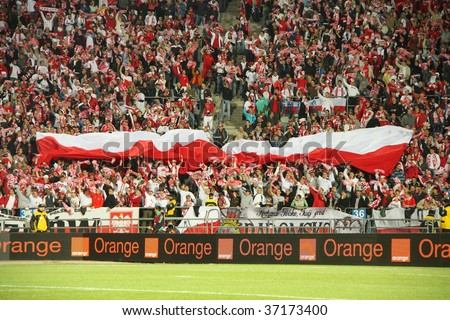 CHORZOW - SEPTEMBER 5: Polish fans in Slaski stadium during the 2010 FIFA World Cup qualification match between Poland and Northern Ireland on September 5, 2009 in Chorzow, Poland.