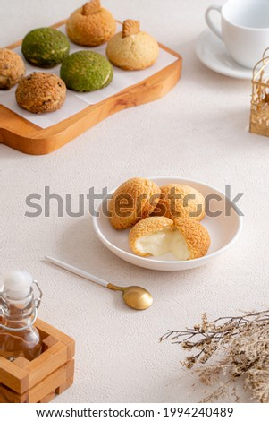 Choux pastry  is a delicate pastry dough used in many pastries. It contains only butter, water, flour, and eggs. Choux pastries are sometimes filled with cream after baking to make cream puffs