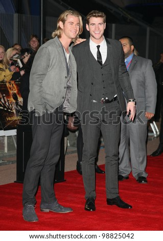 Chris and Liam Hemsworth arriving at the European Premiere of 'The Hunger Games' at the O2 Arena, London. 14/03/2012 Picture by: Alexandra Glen / Featureflash