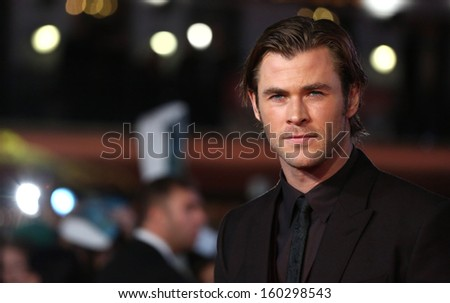 "Chris Hemsworth arriving for the world premiere of ""Thor: The Dark World"" at the Odeon Leicester Square, London. 22/10/2013 - stock photo"