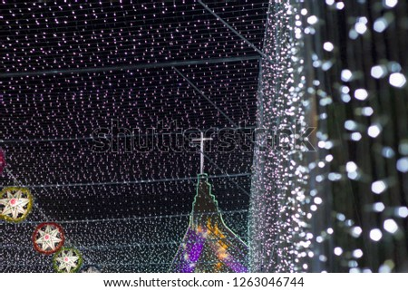 Chrismas Festival ,Light of star,light of Church,lamp of star,light of star,Tunnel of light,Star Wall in the night,Christmas light,at Ban Tha Rae,Sakon Nakhon,Thailand. #1263046744