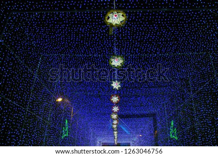 Chrismas Festival ,Light of star,light of Church,lamp of star,light of star,Tunnel of light,Star Wall in the night,Christmas light,at Ban Tha Rae,Sakon Nakhon,Thailand. #1263046756