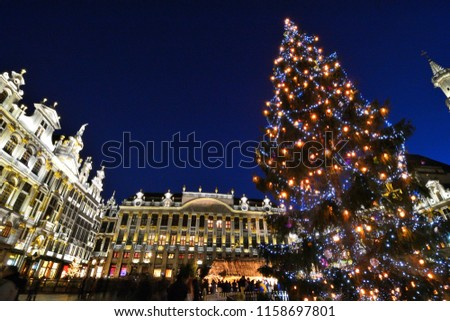Chrismas Tree decorated with colorful lighting at Grand Place Brussel.