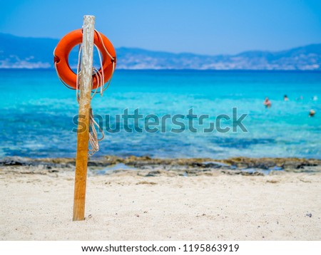 Chrissi Island, Crete, Greece. A lifebuoy on the Golden Beach, symbol of assistance, security, rescue, SOS. Golden Beach in Chrysi island, one of the wildness and gorgeus beach in the world
