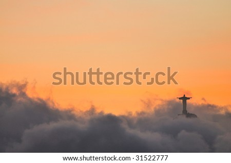 Christ Redeemer at Corcovado sunset