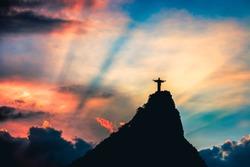 Christ the Redeemer, Cristo redentor at sunset, in Rio de Janeiro - Brazil
