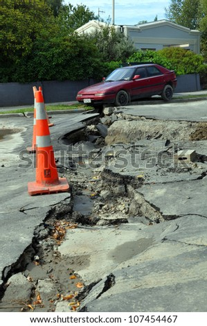 CHRISTCHURCH, NEW ZEALAND - FEBRUARY 24: Car falls into a crack caused by the largest and most devastating earthquake Christchurch has experienced on February 24, 2011 in Christchurch.
