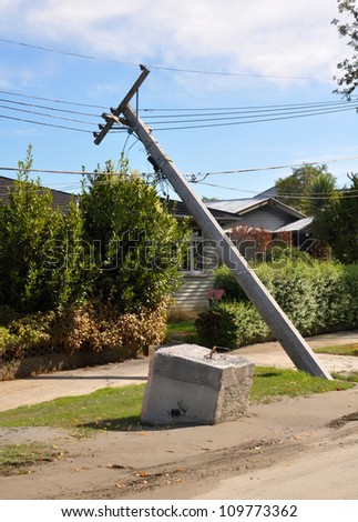 CHRISTCHURCH, NEW ZEALAND - FEBRUARY, 24: Earthquake liquefaction causes power polls and cables to collapse on February 24, 2011 in the Christchurch suburb of Avonside.