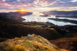 Christchurch New Zealand Landscape, Sunrise Scenic View From Port Hills Overlooking Lyttelton Harbour In Canterbury, South Island NZ. Early Morning Coastal Scenery, Popular Travel Destination