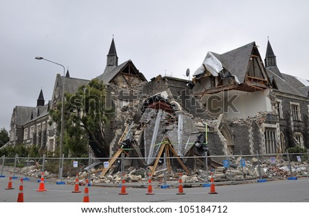 CHRISTCHURCH, NEW ZEALAND - MARCH 12: The old Normal School Building on the corner of Montreal and Kilmore streets collapses after a huge earthquake on March 12,  2011 in Christchurch.