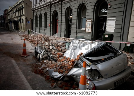 CHRISTCHURCH, NEW ZEALAND - SEPT 9:  A car lies crushed after a 7.1 magnitude earthquake that struck on 4 September. Strong aftershocks continue.  9 September 2010 in Christchurch, New Zealand.