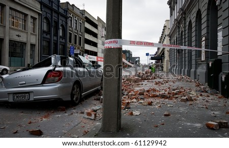 CHRISTCHURCH, NEW ZEALAND - SEPT 9: A car lies crushed following a 7.1 magnitude earthquake that struck on 4 September. Strong aftershocks continue. 9 September 2010 in Christchurch, New Zealand.