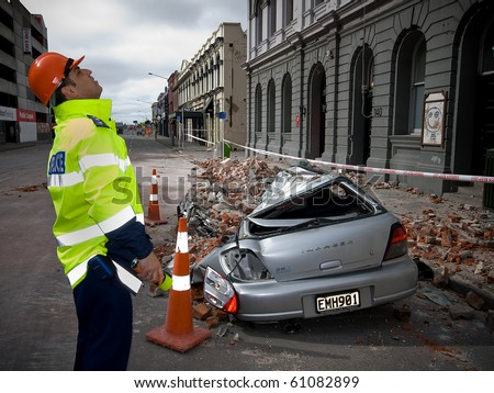 CHRISTCHURCH, NEW ZEALAND - SEPT 9:  Police inspect damage a 7.1 magnitude earthquake that struck on 4 September. Strong aftershocks continue.  9 September 2010 in Christchurch, New Zealand.