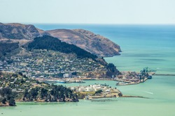 Christchurch New Zealand. Wide scenic landscape view of Lyttelton Harbour and Banks Peninsula from the top of the port hills. Popular tourism travel destination in Canterbury, South Island.