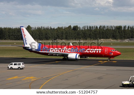 CHRISTCHURCH, NZ - MARCH 18: Pacific Blue Airlines B737 on March 18, 2009 at Christchurch International Airport. Pacific Blue have launched their premium economy class in March 2010.
