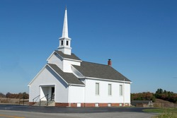 Christian background photo of a country church with a clear, blue sky in the background
