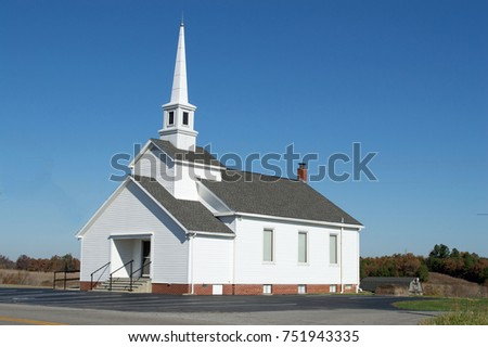 Christian background photo of a country church with a clear, blue sky in the background #751943335