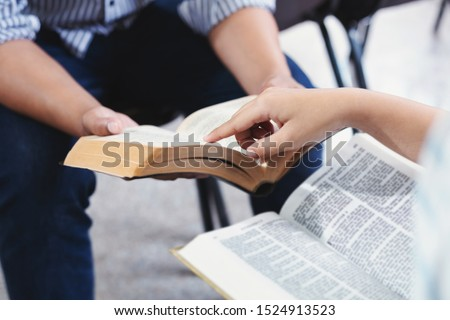 Christian bible god deliver devotional with hand friendship Holy Bible study  reading together in Sunday school Stock photo ©