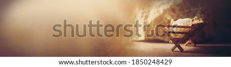 Christian Christmas concept. Birth of Jesus Christ. Jesus is reason for season. Salvation, Messiah, Emmanuel, God with us, hope. Wooden manger and star of Bethlehem in cave, nativity scene background Photo stock ©