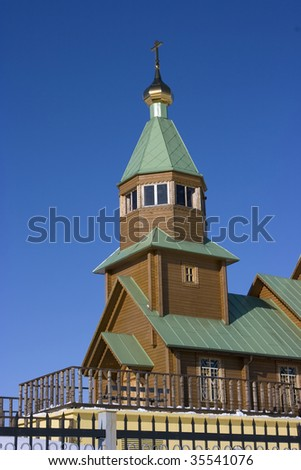 Christian church against the blue sky and clouds