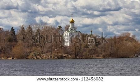 christian church on a river coast