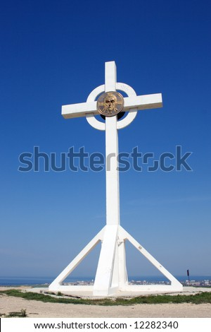 Christian cross against the blue sky