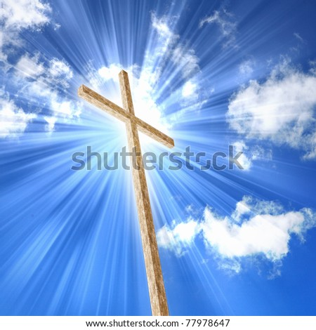 Christian cross against the sky in a blaze of glory. Religious symbol of Christianity