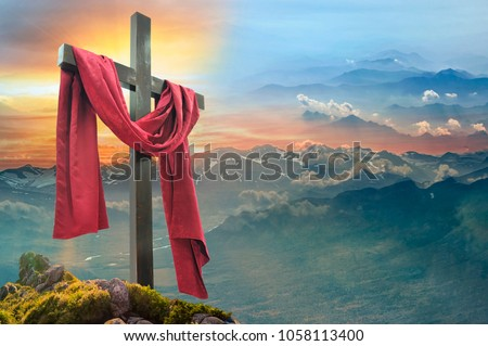 Christian cross against the sky over the mountains