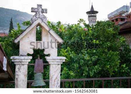 christian cross and islamic minaret together in a frame #1562563081