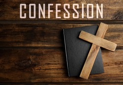 Christian cross, Bible and word Confession on wooden background, top view