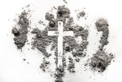 Christian cross, crucifix symbol, sign made in ash, dust. Ash Wednesday concept